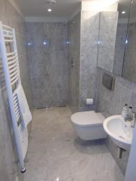 Contemporary wetroom in Marble with hand-built furniture